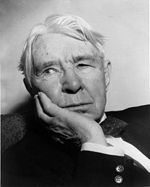 black and white portrait of an older man with white hair and a suit