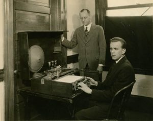 Inventor Robert Naumburg and reader Toivo Laminan with Visagraph, c. 1931. The first model of the Visagraph, pictured here, scanned inkprint and produced either a vibratory or sound output (an interrupted buzz). Later models converted inkprint to raised lines on a sheet of foil. Lilly Spirkovska of NASA conjectures that the Visagraph might be the first human-machine tactile interface. Courtesy of the American Foundation for the Blind.