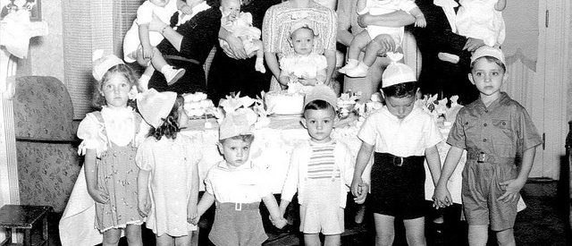 Vintage picture of a large group of children and mothers, celebrating a child's birthday