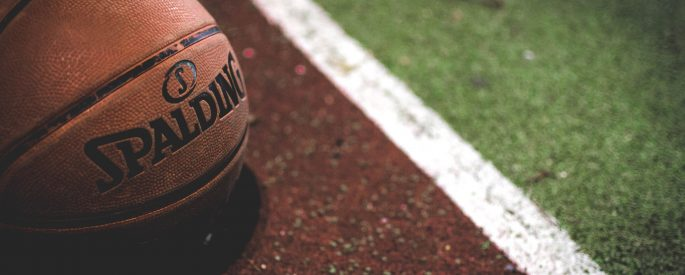Basketball sitting on track.