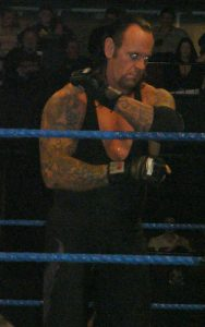 The Undertaker preps for a signature Tombstone Piledriver.