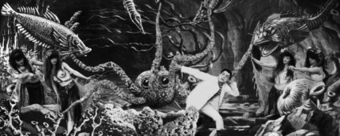 Scene from a Georges Méliès film depicting a man running scared from alien plants
