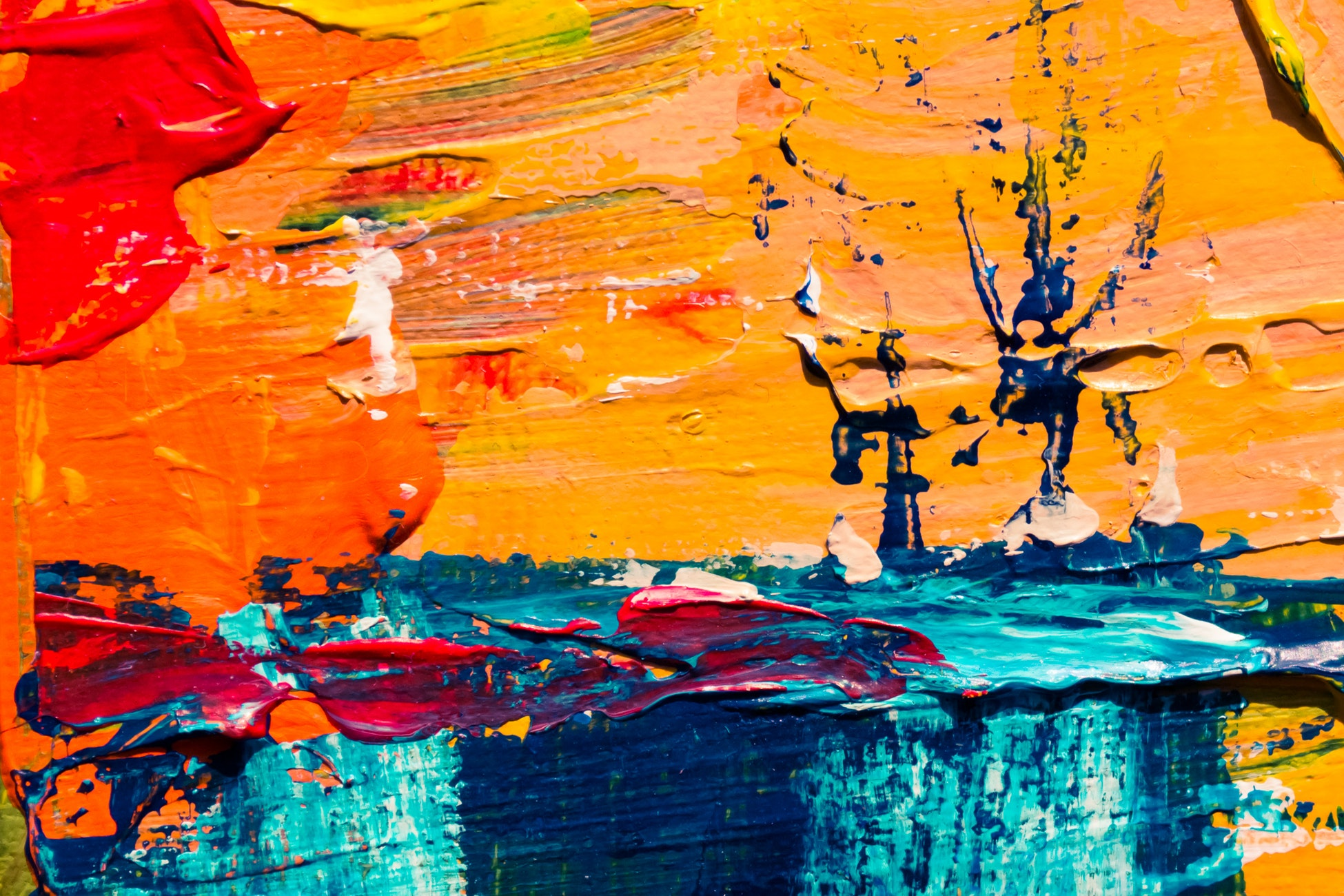 Abstract canvas art with red, orange, yellow, and blue on canvas. Oil on canvas.