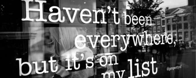 "Black and white photo of a window with the quote ""Haven't been everywhere but it's on my list"" written on it"