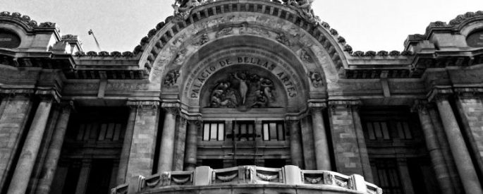 Black and white photo of the arch over the entrance of Bellas Artes in Mexico City