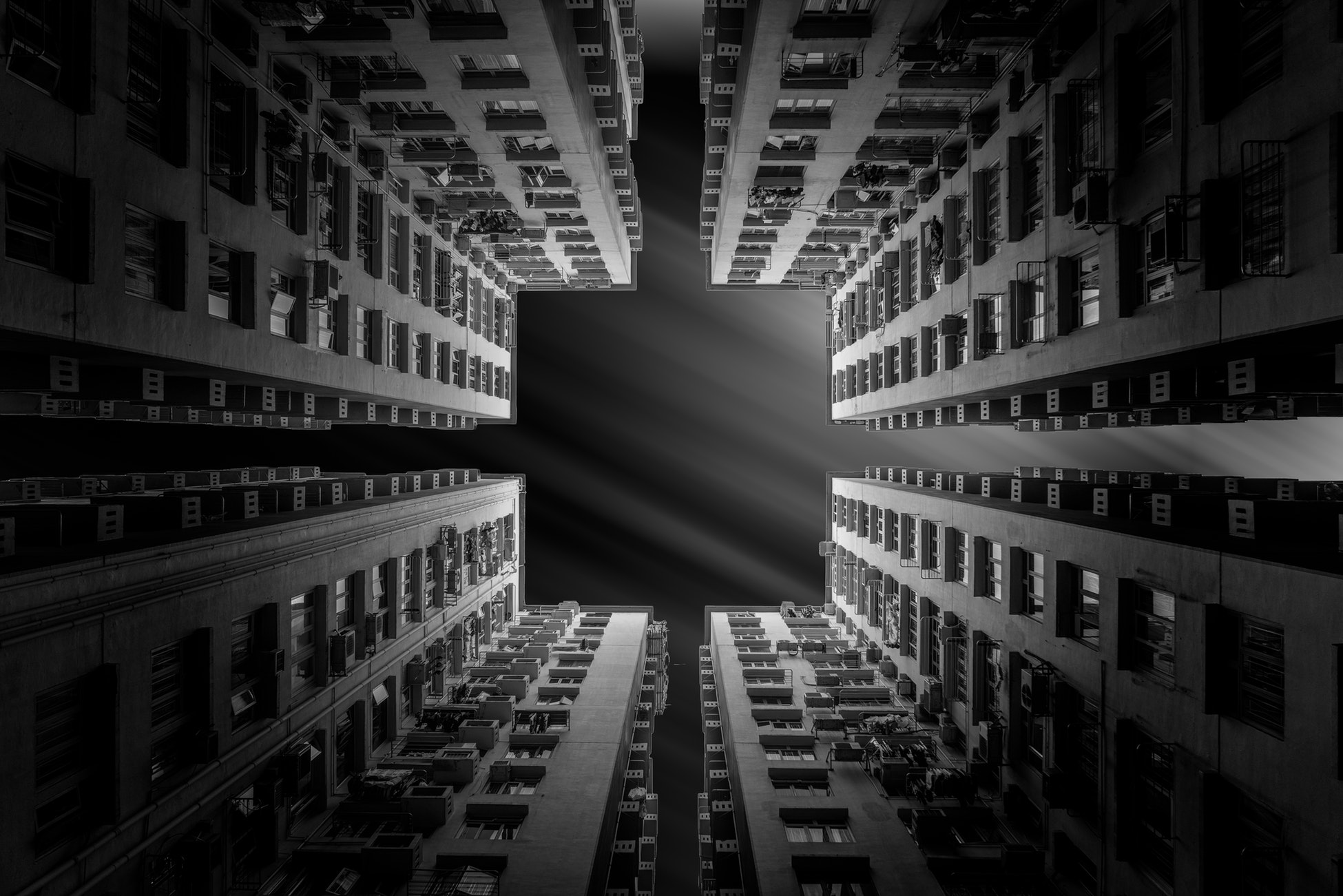 Four buildings in black and white make a square.
