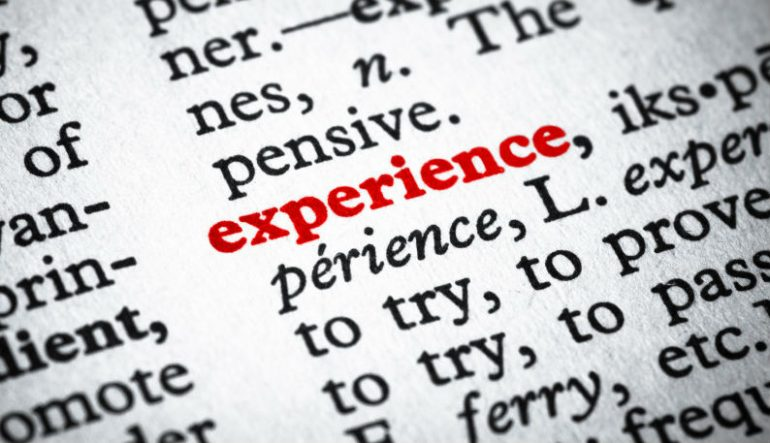 "Dictionary entry of the word ""experience"" in red"
