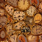 Lots of clocks side by side in difference shapes and sizes.