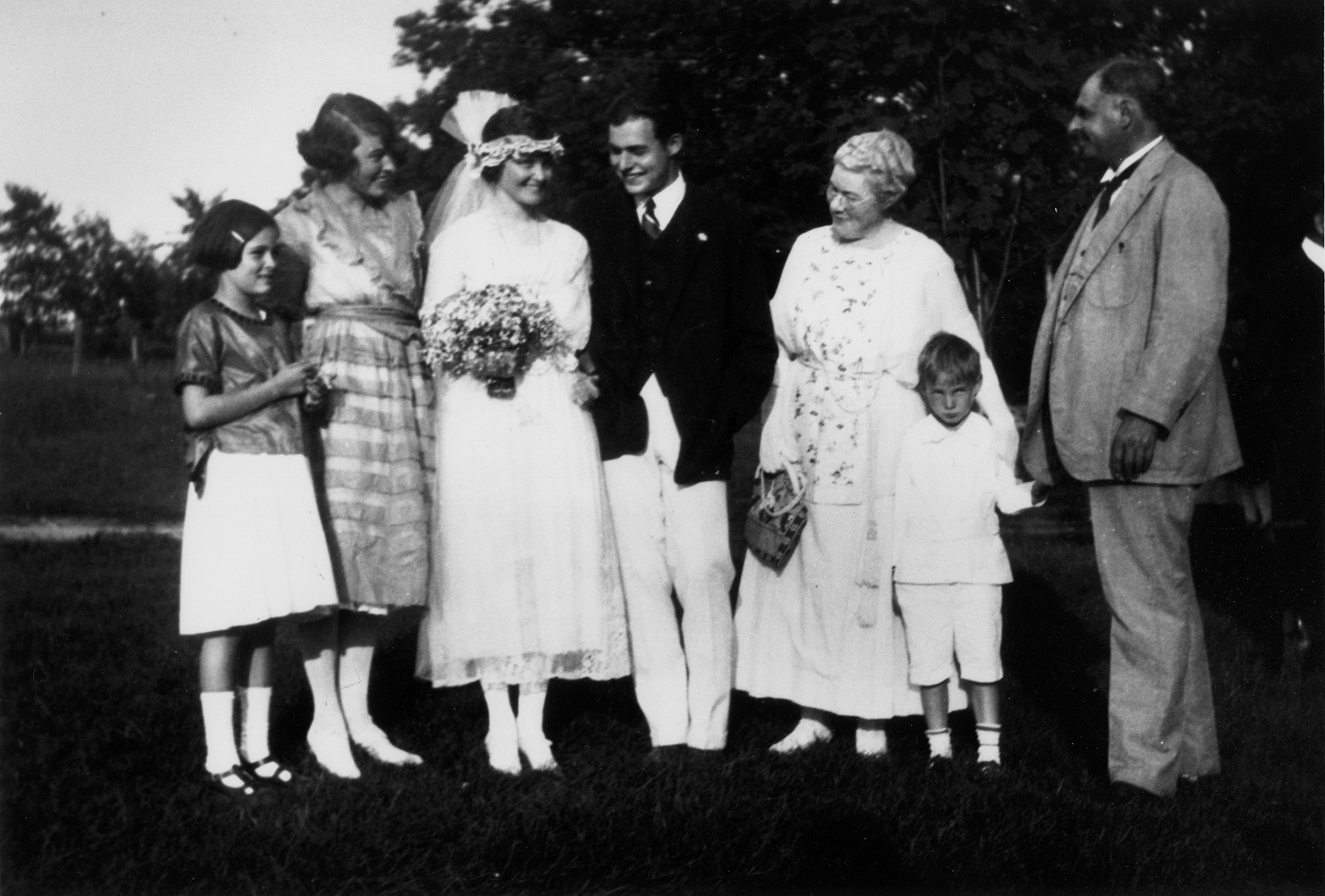 Black and white photo of a family at an old time wedding