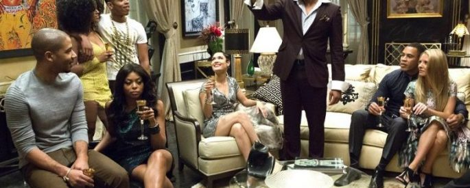 A still from the TV show Empire, showing the cast in a living room as one character makes a toast