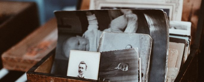 Old photos in a brown box.