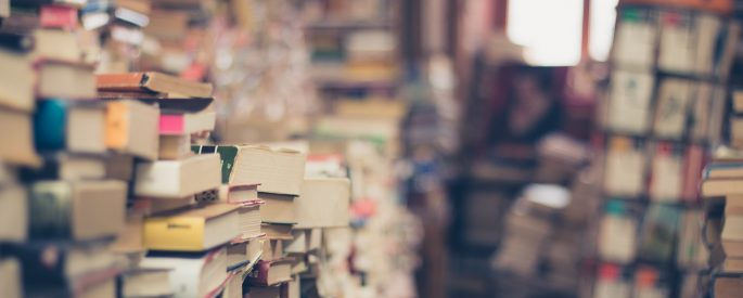 Stacks of books in shallow focus.