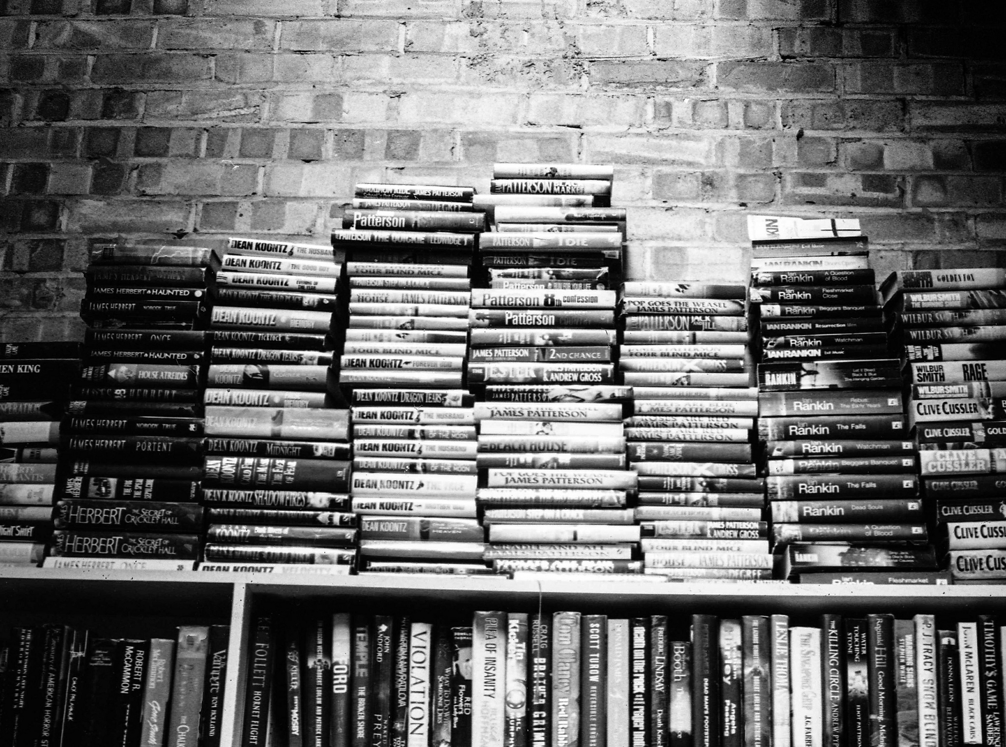 Black and white photo of stacks of books