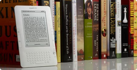 Photo of a e-reader against a row of print books