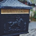 A cast iron post box.