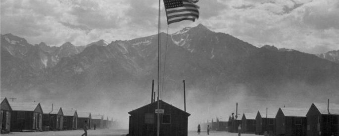 American flag in front of a prison camp