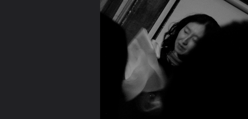 Black and white, blurry picture of an Asian woman.
