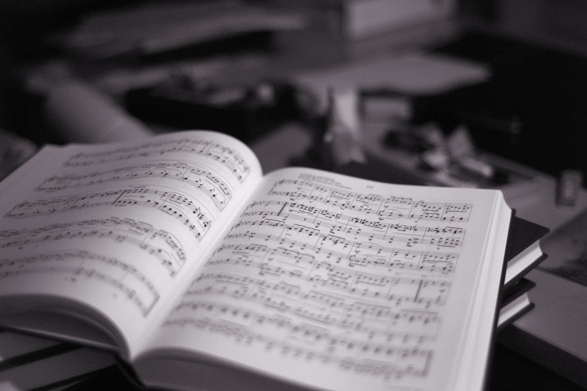 Black and white picture of a book of music sheets.