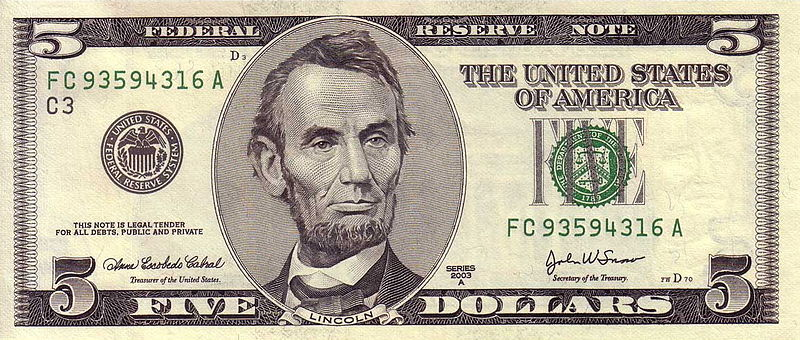 Picture of a five dollar bill, Lincoln side up