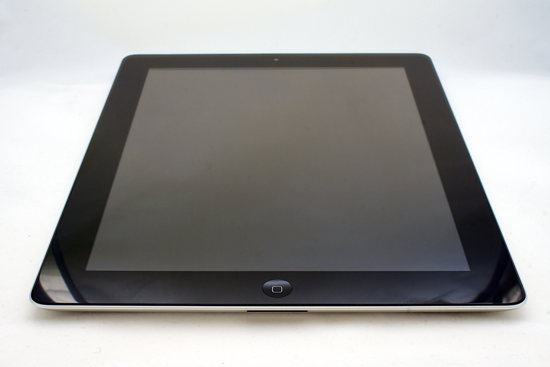 Picture of an iPad lying on a white surface.