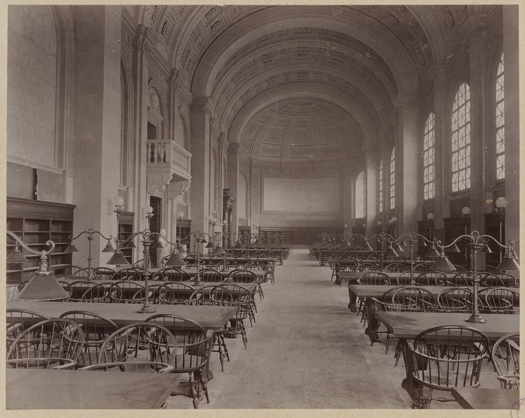Old sepia picture of the reading room inside the Boston Public Library.