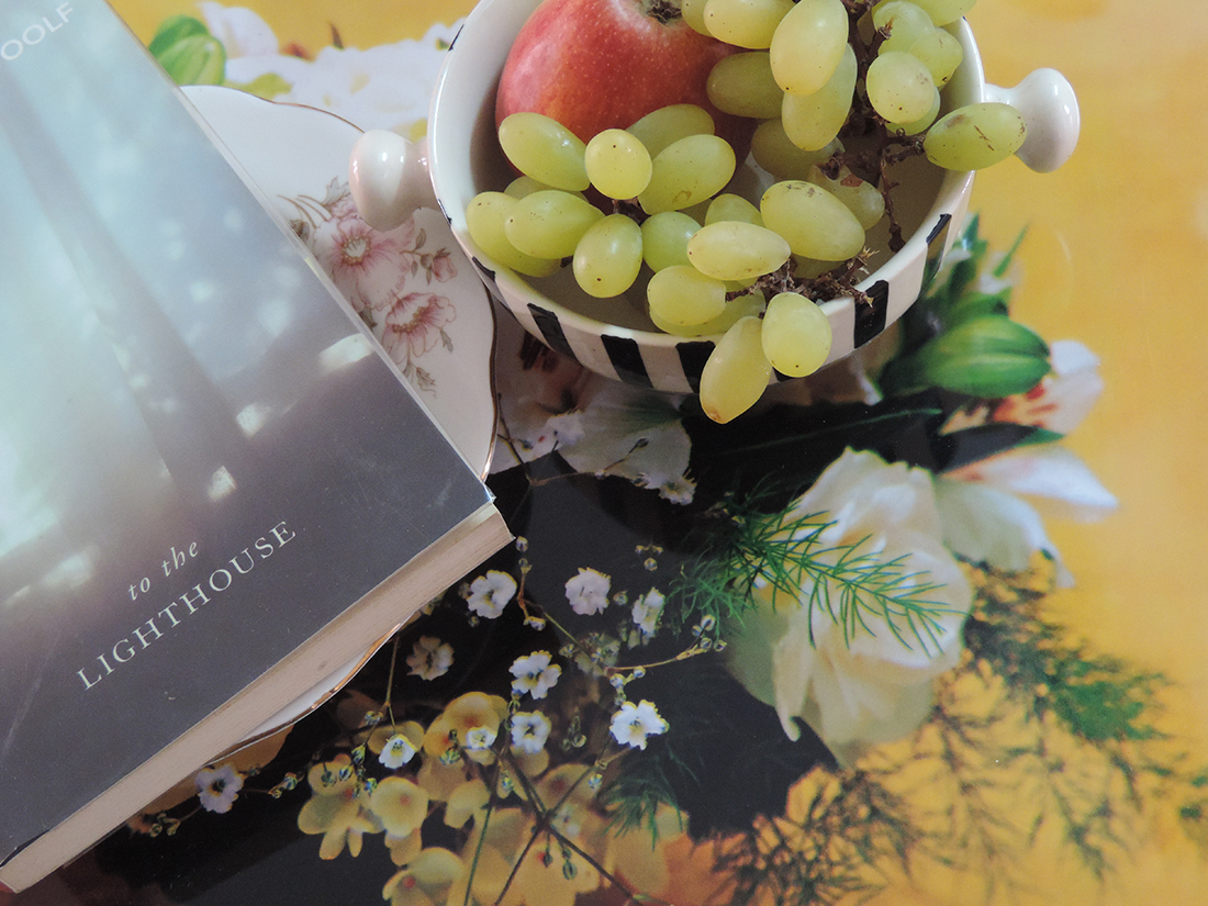 Picture of a fruit bowl sitting next to To The Lighthouse by Virginia Woolf