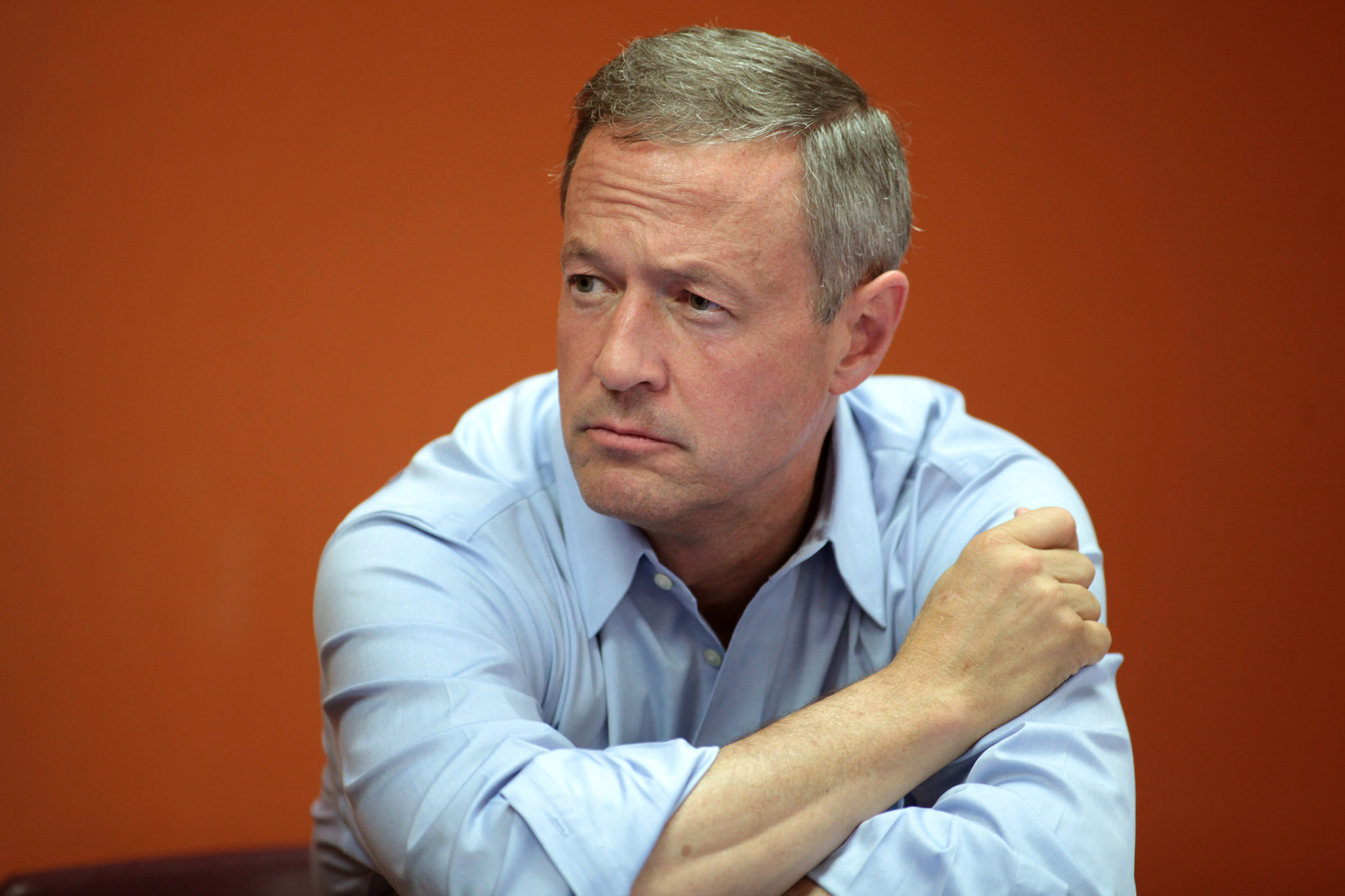 Picture of Martin O'Malley sitting down against an orange background