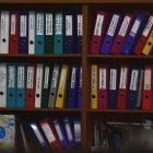 assorted files on shelf