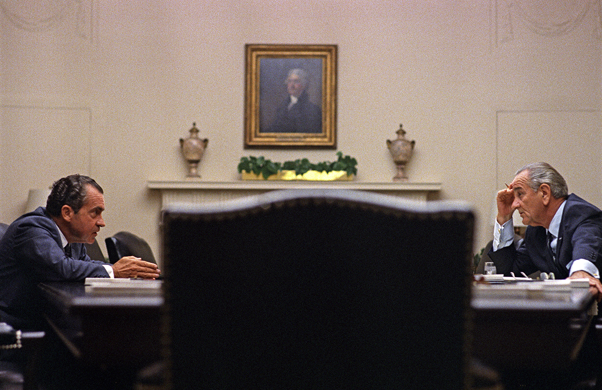 Picture of Nixon & Johnson talking to each other across the table
