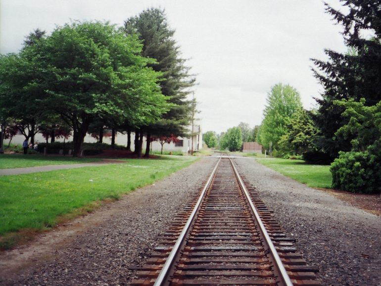 Picture of train tracks going through a town