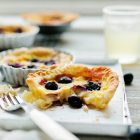 pie with berries beside fork