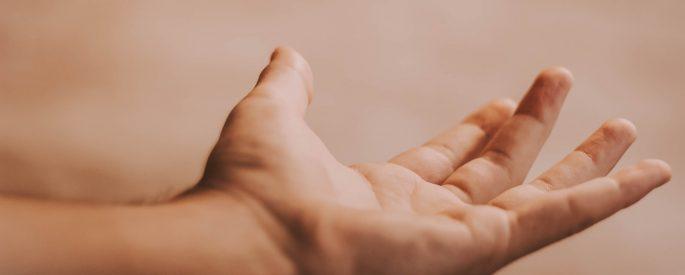 Left human hand open.
