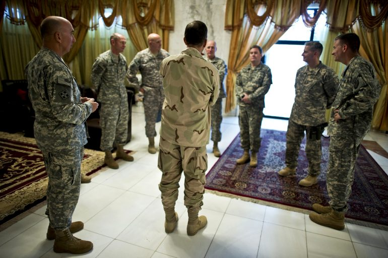 Picture of a group of soldiers standing in a circle - Image courtesy of US Army