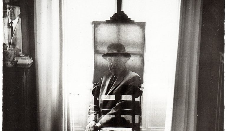A face overlayed in front of an easel