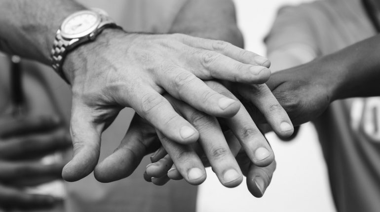 Black and white picture of overlapping hands