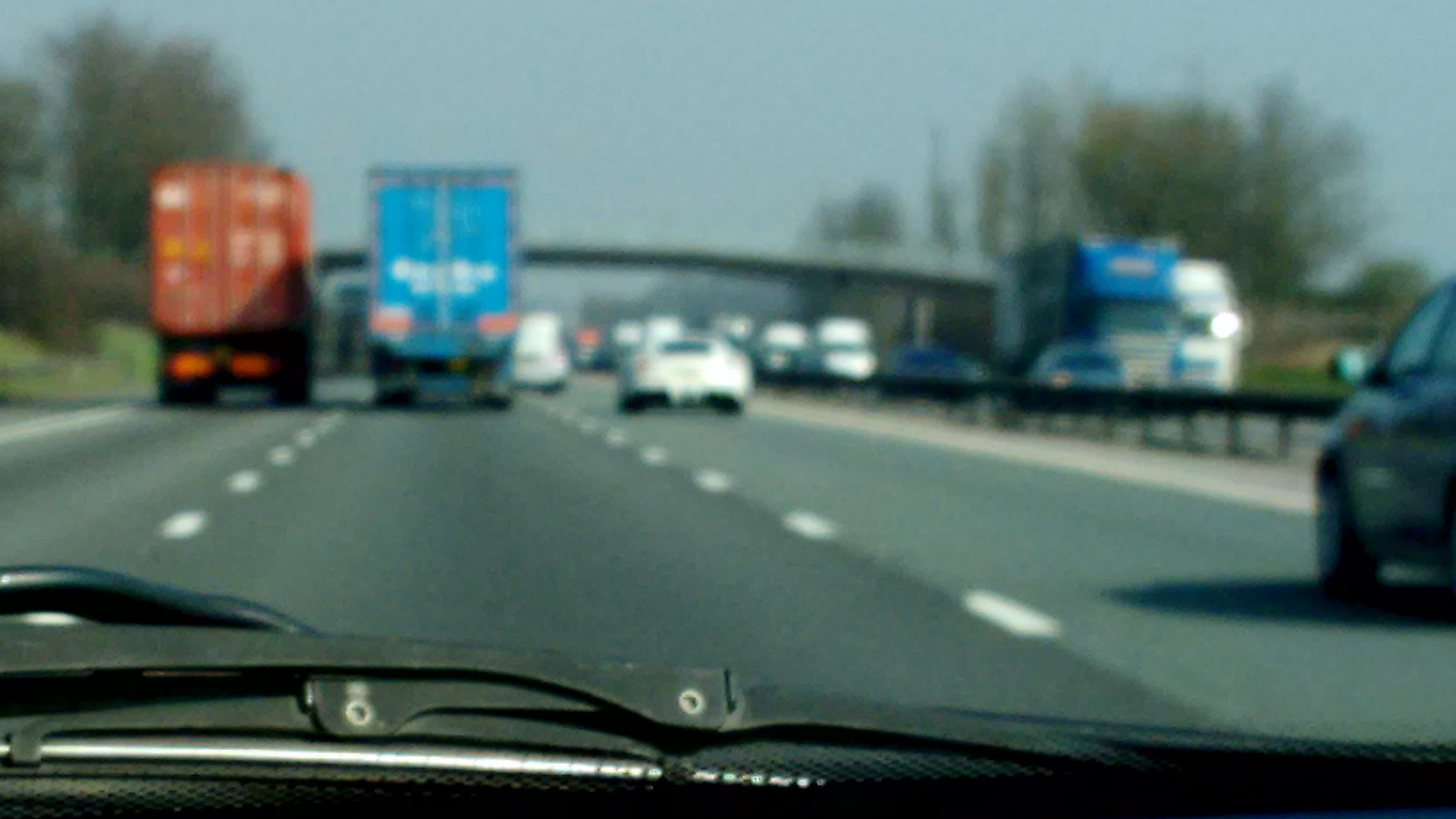Picture of a a highway taken through a car's windshield