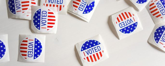 I voted stickers on white table.