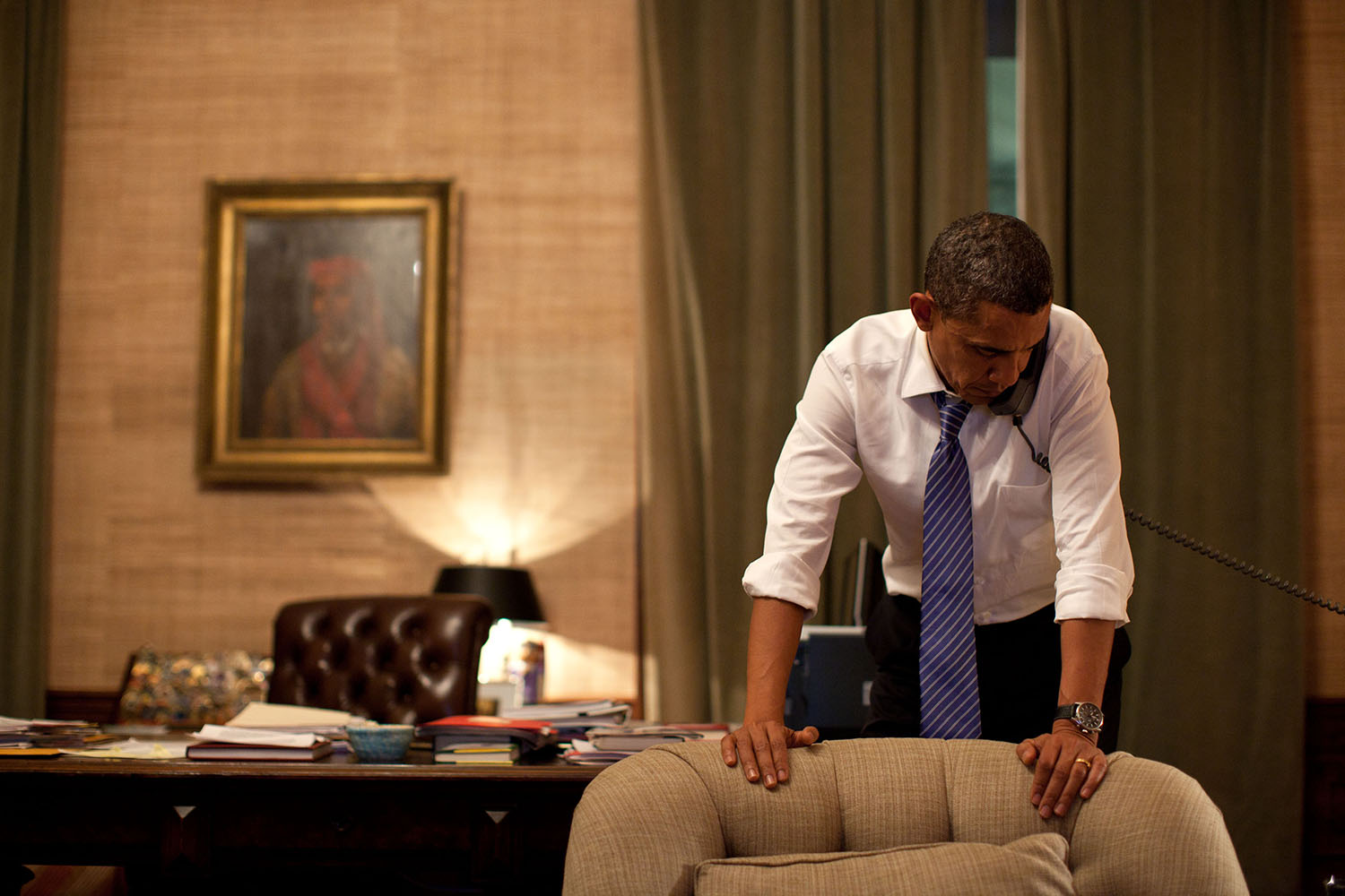 """Nov. 23, 2010 """"Late at night in the Treaty Room office in the White House Residence, the President speaks on the phone to President Lee of South Korea after North Korea had conducted an artillery attack against the South Korean island of Yeonpyeong."""" (Official White House Photo by Pete Souza)  This official White House photograph is being made available only for publication by news organizations and/or for personal use printing by the subject(s) of the photograph. The photograph may not be manipulated in any way and may not be used in commercial or political materials, advertisements, emails, products, promotions that in any way suggests approval or endorsement of the President, the First Family, or the White House."""