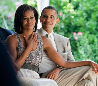 1024px-Barack_and_Michelle_Obama_watching_a_wedding-580x387