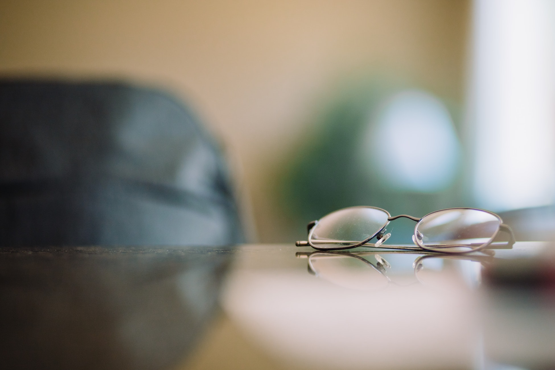picture of gray framed eyeglasses on table