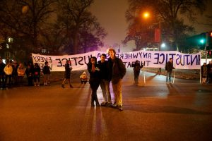 Photo of St. Louis Students in Solidarity actionblocking an intersectionnear Washington University in St. Louis