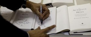Barack Obama signing books.