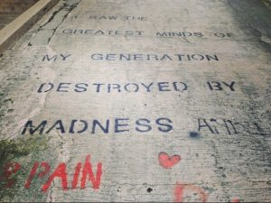 Picture of a poem graffitied on the sidewalk.