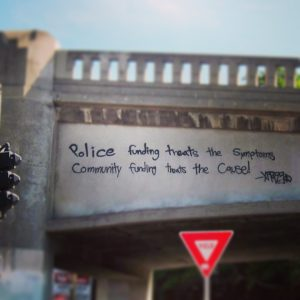 Picture of words graffitied on a bridge.