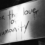 """Picture of a foggy mirror with the words """"for the love of humanity"""" written on it"""