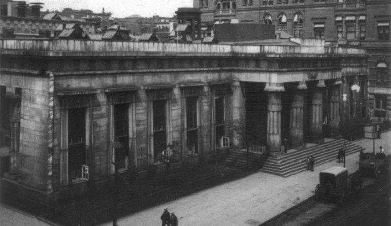 Old black and white picture of the outside of a bank