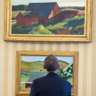 Barack Obama looks at two Edward Hopper paintings.