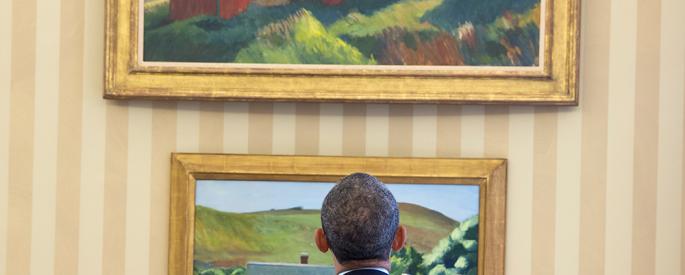 Barack Obama looks at two Edward Hopper paintings.