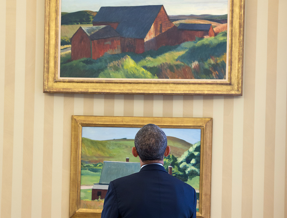 Picture of Barack Obama looking at two Edward Hopper paintings.