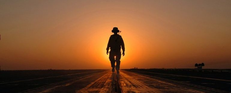 Person walking towards the sunset
